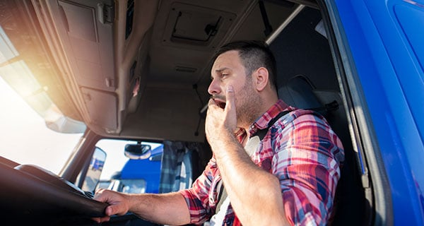 Commercial truck driver yawning