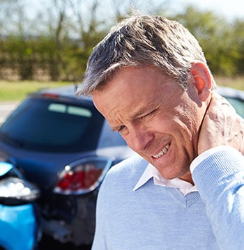 Man holding his neck after car accident