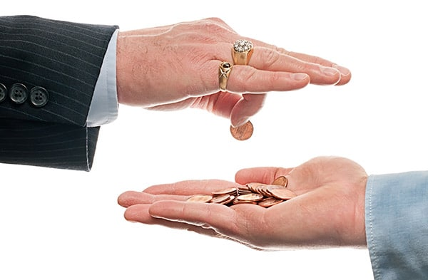 Employer handing pennies to employee