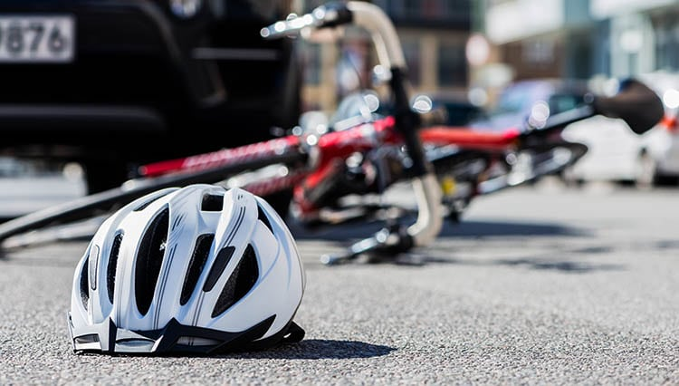 Bicycle on ground after collision with vehicle