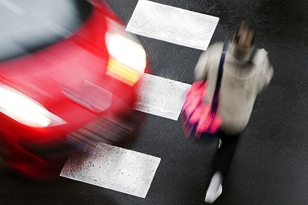 Car swerving towards pedestrian in crosswalk