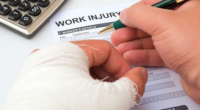 Injured employee filling out work injury form