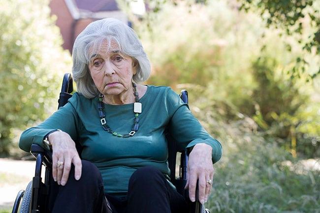 Depressed senior citizen at nursing home
