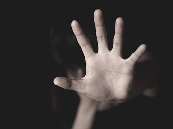 Assault victim holding hand up