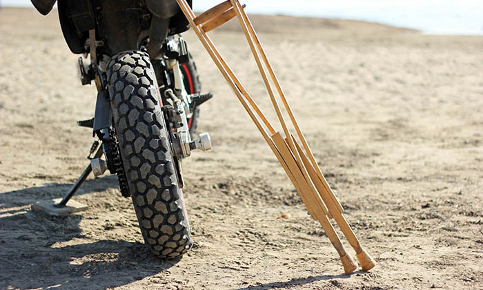 Motorcycle with pair of crutches