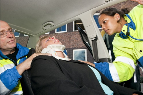 Woman being helped by emts