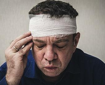 Head injury victim holding head