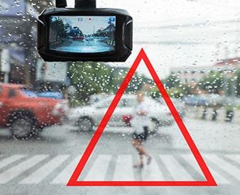 Pedestrian in crosswalk in front of vehicle