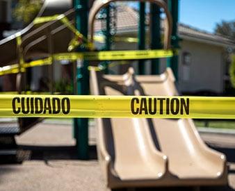 Yellow tape around playground structures