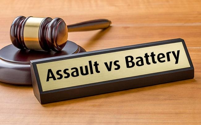 Gavel next to Assault vs Battery plaque