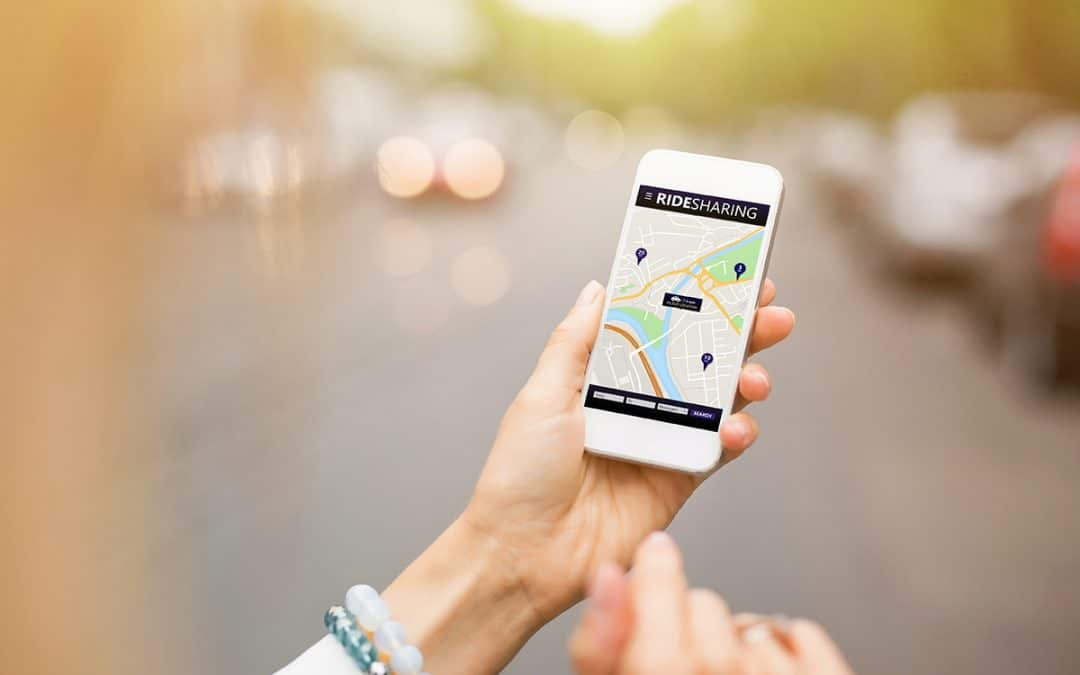 rideshare app hailing a ride on the phone