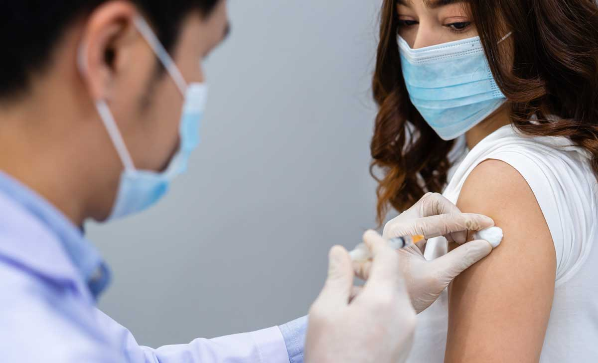 doctor giving patient a vaccine injection