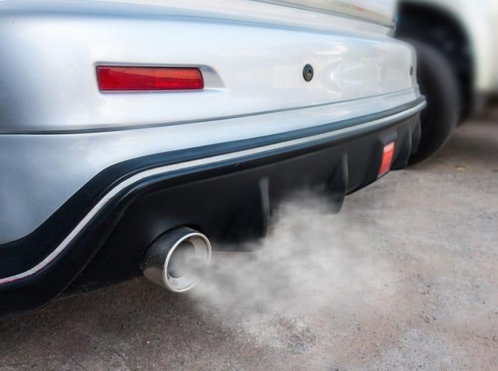 Car exhausting carbon monoxide